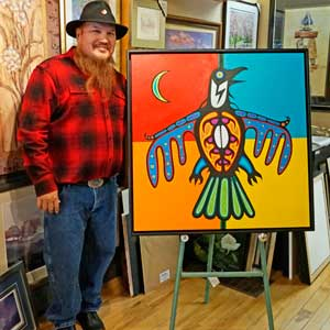 "Jeff ""Red"" George beside on of his paintings (Photo: J. Baillie)"